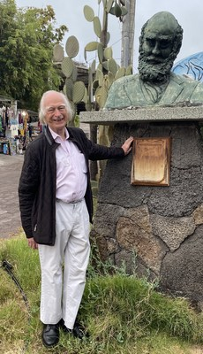Famed Oxford Scientist Denis Noble stands next to a bust of Charles Darwin on the Galápagos Islands, where Darwin developed his Theory of Evolution. Noble believes textbooks have omitted much of Darwin's original work and says correcting how evolution is taught holds the key to curing diseases. (PRNewsfoto/Natural Code LLC)